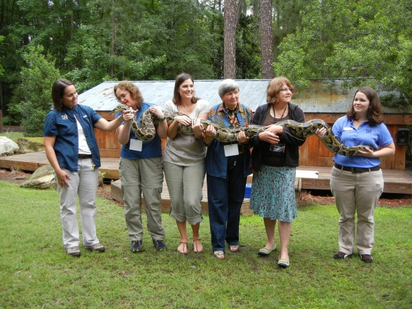 Freelancer Julia Bayly (second from left) helps display the 9-foot python at Georgia Southern University. In spite of efforts at an interview, Xena the snake had no comment.