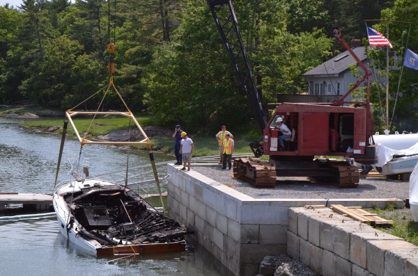 Officials investigate a boat explosion that injured two people at New Meadows Marina in Brunswick on Monday, May 28, 2012. Brunswick fire officials said a husband and wife were hospitalized after their 36-foot pleasure boat exploded while they were fueling it up at the marina.