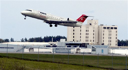 In this May 18, 2005 file photo, a passenger jet lifts off from the runway at Bangor International Airport in Bangor, Maine. Because of the airport's location at the northeastern corner of the U.S., trans-Atlantic flights confronted with terror threats or unruly passengers are often diverted to Bangor, population 33,000.