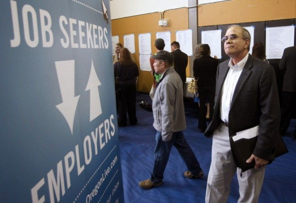 Job seeker Alan Shull attends a job fair in Portland, Ore. The Labor Department said Friday that the economy added just 115,000 jobs in April.