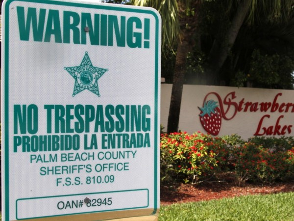 A no-trespassing sign sits in front a neighborhood called Strawberry Lakes, in Lake Worth, Fla. National foreclosure trends took a positive turn in April, as the number of homes seized by banks declined and fewer properties entered into the foreclosure process, RealtyTrac Inc. said.