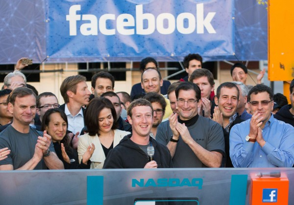 In this May 18, 2012 file photo provided by Facebook, Facebook founder, Chairman and CEO Mark Zuckerberg, center, rings the Nasdaq opening bell from Facebook headquarters in Menlo Park, Calif. Robert Greifeld, second from right, CEO of the Nasdaq-OMX Stock Market, Inc., said Sunday, May 20, the stock exchange is &quothumbly embarrassed&quot by its bungling of Facebook's debut. Facebook's stock was expected to start trading at 11 a.m. Friday, but didn't open until 11:32 a.m., and some investors didn't learn for hours whether their orders went through. (AP Photo/Nasdaq via Facebook, Zef Nikolla, File)