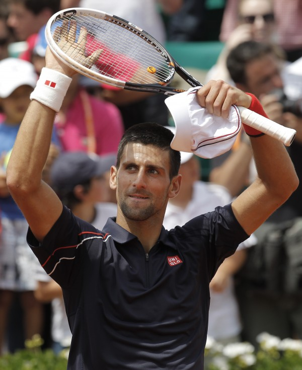 Novak Djokovic of Serbia celebrates winning his second round match against Blaz Kavcik of Slovenia at the French Open tennis tournament in Roland Garros stadium in Paris on Wednesday, May 30, 2012.