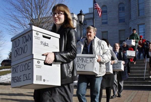Whitney Gifford of Bucksport leads a group of gay marriage supporters carrying signed petitions to the Secretary of State's office in Augusta in January 2012. A flurry of political activity in states such as Rhode Island, Illinois and Colorado followed President Barack Obama''s declaration of support for gay marriage, which has emboldened activists and politicians on both sides of the issue ahead of anticipated votes in four states this fall, including Maine and Maryland.