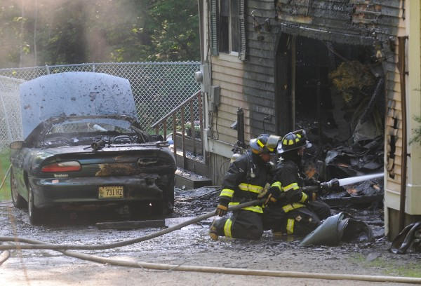 Firefighters from Holden, Orrington, Eddington and Brewer put out a fire that gutted part of a residence and car at 63 Eaton Ridge Drive in Holden late Thursday afternoon, May 31, 2012.