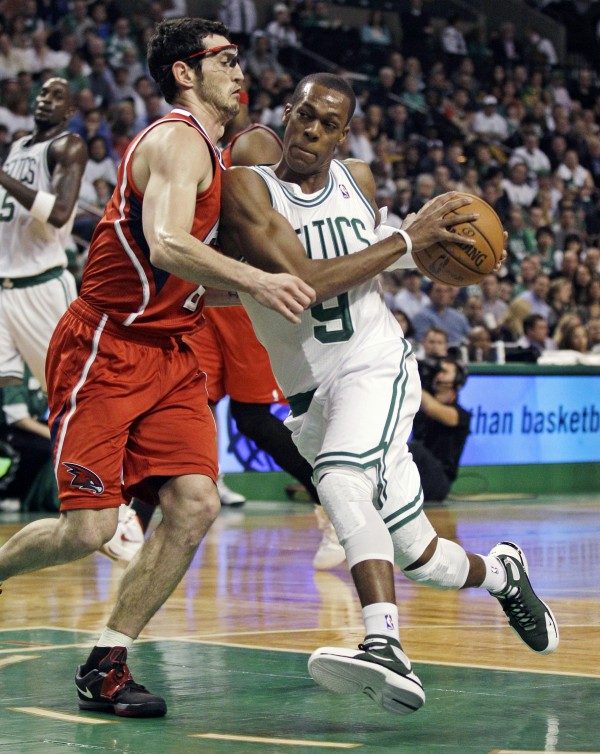 Boston Celtics guard Rajon Rondo (9) drives to the basket against Atlanta Hawks guard Kirk Hinrich (6) during the first quarter of Game 3 of an NBA first-round playoff series, Friday, May 4, 2012, in Boston.