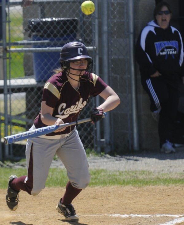 Caribou High School's Jordyn Doucette pops up a bunt in game action at U Maine's Kessock Field Saturday afternoon, May 12, 2012.