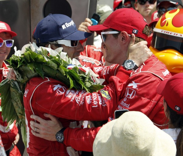 Dario Franchitti, left, of Scotland, is congratulated by Scott Dixon, of New Zealand, after Franchitti won IndyCar's Indianapolis 500 auto race at Indianapolis Motor Speedway in Indianapolis, Sunday, May 27, 2012.