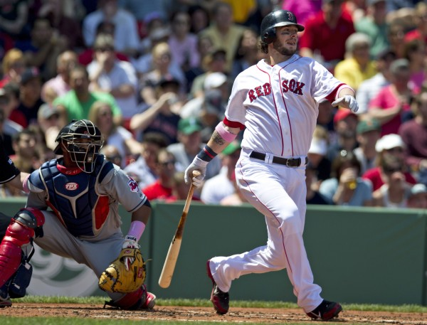 Boston Red Sox's Jarrod Saltalamacchia watches his two-run single off Cleveland Indians' Justin Masterson during the first inning of a baseball game at Fenway Park, in Boston, Sunday, May 13, 2012. Indians catcher Carlos Santana is at left.