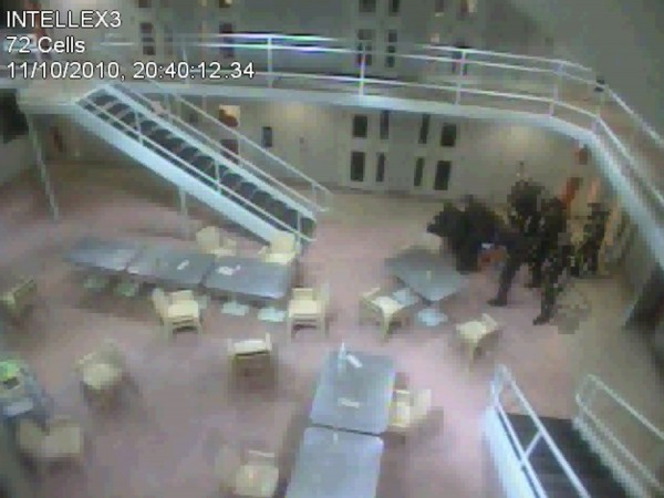 The American Civil Liberties Union of Maine filed a lawsuit Tuesday, May 8, 2012 against two former guards at the Cumberland County Jail. The lawsuit alleged the guards beat a man from El Salvador being held for deportation.  This photo, taken from a November 10, 2010 surveillance video, shows a group of guards who appear to be helping to restrain the inmate.