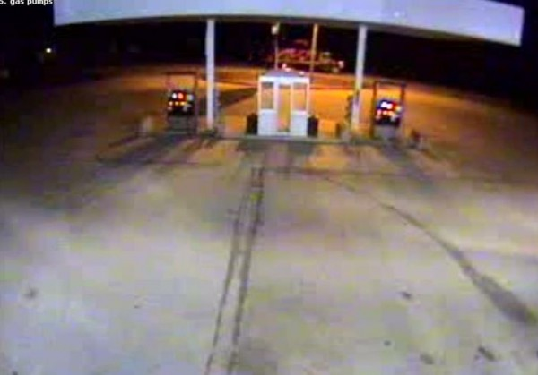 This surveillance photo from a nearby gas station shows the tractor on the back of a red ramp truck along Route 17, as it passed the station.