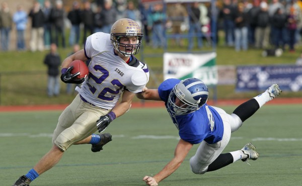 Chevrus' Donald Goodrich breaks a tackle by Lawrence's Anthony Sementelli on a second quarter run during  the Class A state championship football game, Saturday, Nov. 19, 2011, at Fitzpatrick Stadium in Portland.
