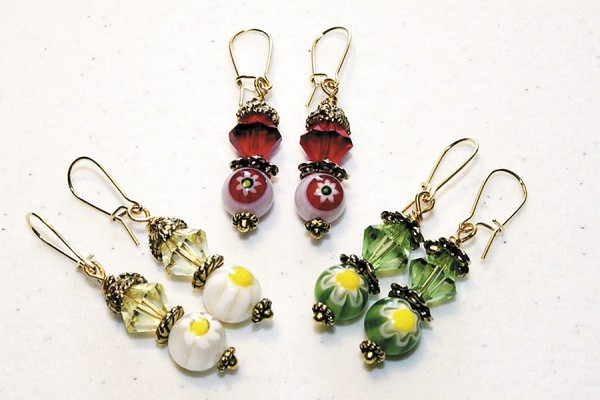 Michaud has created earrings specifically for mother's day. The floral earrings shown in this photograph are part of her Mother's Day Bouquet Collection. From left to right counter clockwise: &quotEverything's Coming Up Daisies&quot, &quotRed Rose Rapture&quot, and &quotThe Grass Is Always Greener&quot. She used glass millefiori beads, Swarovski crystals and gold plate bead caps and ear wire.