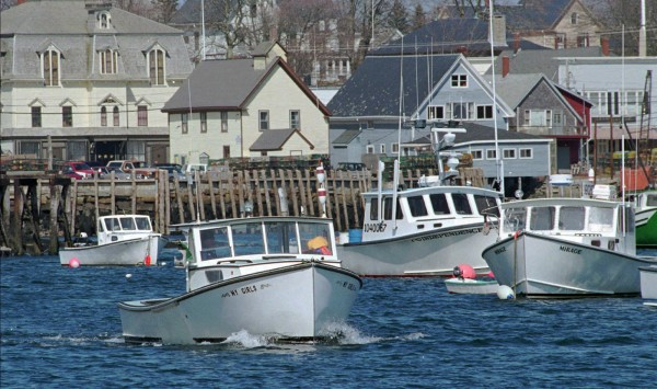 This April 16, 1997 file photo shows a lobster boat heading out of Vinalhaven Harbor, in Vinalhaven, Maine.