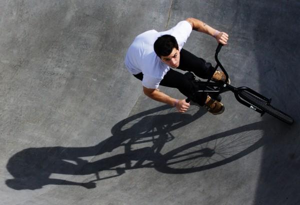 Alex Dodge circles the pool on his BMX at the Portland skate park Monday, April 30, 2012.