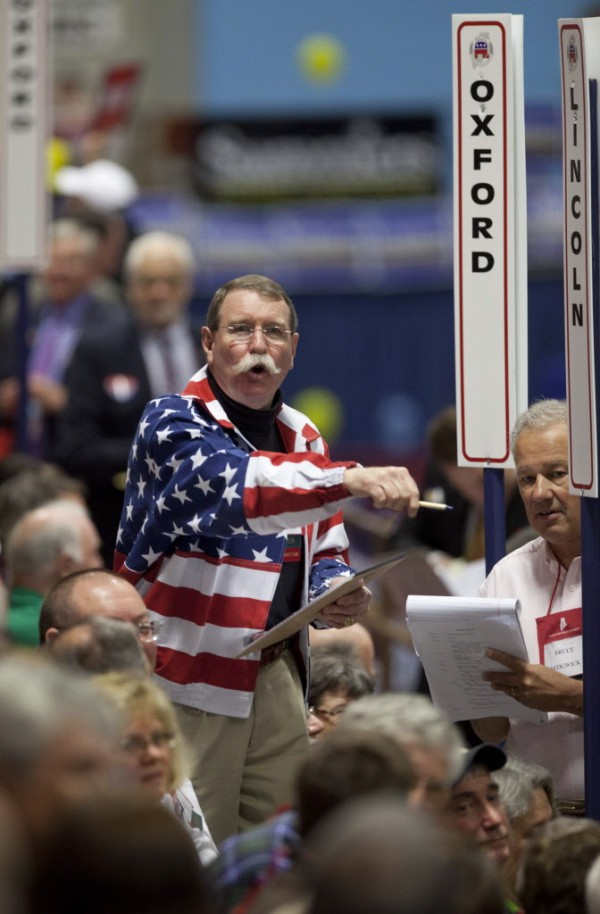 James Carlton of the Lincoln County State Committee counts votes of his county's delegates during the election of national committeemen at the Maine Republican Convention at the Augusta Civic Center in Augusta, Maine, Saturday, May 5, 2012.