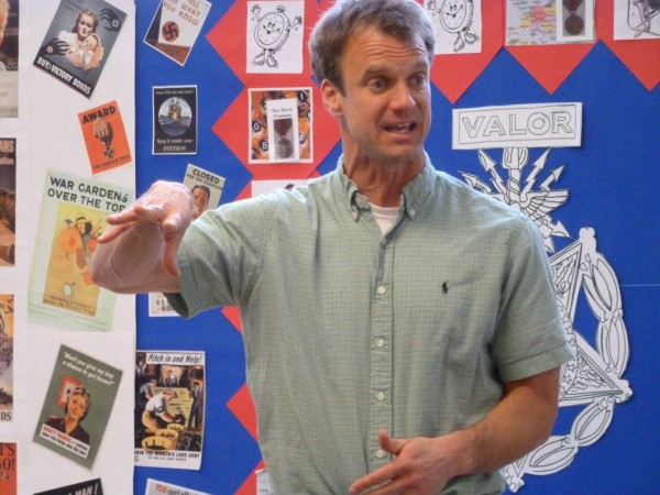 Sixth-grade teacher Jim Morse gestures emphatically during a social studies class at Camden-Rockport Middle School recently. Male teachers make up less than a third of all teachers in Maine -- which is more than most states. Maine is 12th in the nationin the number of male teachers.