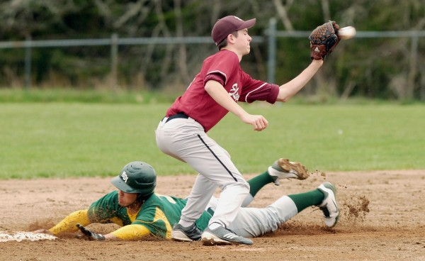 MDI's Cam Crawford (3) slides into second base ahead of the tag by Ellsworth's Brandon Braley (8) in the third inning at Bar Harbor Saturday afternoon, May 5, 2012. Ellsworth won 2-1.