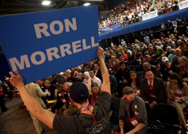A backer of pro-Ron Paul candidate Ron Morrell for Maine GOP convention secretary rallies support on the floor Saturday morning May 5, 2012, in Augusta.