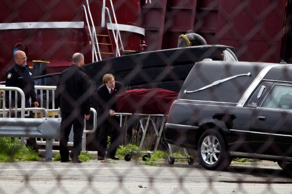 A body is loaded into a hearse Tuesday, May 22, 2012 at 12:45 p.m. at the Ocean Gateway Terminal in Portland.