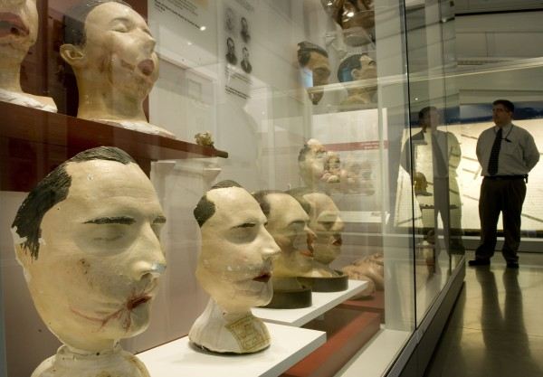 Tim Clarke Jr., deputy communications director at the National Museum of Health and Medicine in Silver Spring, Md., stands near a display of facial casts of Civil War combatants taken for surgeons who attempted reconstruction.