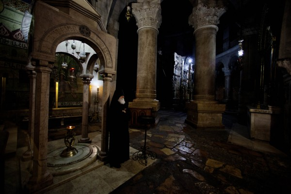 Armenian Orthodox priest Father Samuel stands in the Holy Sepulcher church in Gaza on Friday, May 18, 2012. In a centuries-old tradition, clerics from the three largest denominations in the church, the Greek Orthodox, Armenians and Roman Catholics, gather each night for special prayers reserved for the men who take care of the site where Christians believe Jesus was crucified, buried and resurrected.