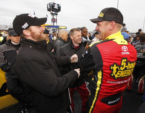 Dale Earnhardt Jr. (left) jokes with Clint Bowyer (right) and Jeff Burton (center) before the NASCAR Sprint Cup Series race at Richmond International Raceway in Richmond, Va., Saturday, April 28, 2012.