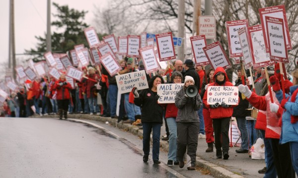Striking nurses picket in front of Eastern Maine Medical Center along State Street in Bangor in 2010.
