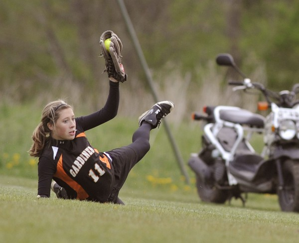Gardiner High School softball player Kelsey Moody (11) makes a sliding catch in foul territory for an out in the sixth inning of a game against Oceanside High in Thomaston, Maine, Friday, May 12, 2012.