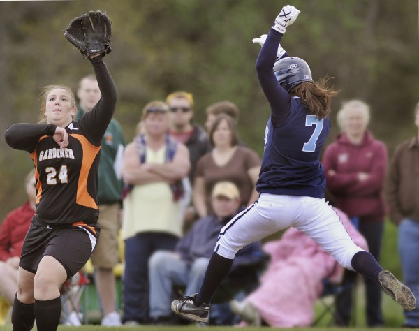 Oceanside High School softball player Tamara Wallace (4) leaps for first base to beat the throw to Brit Rollins (24) on an infield hit in the fourth inning of a game against Gardiner High School in Thomaston, Maine, Friday May 12, 2012.
