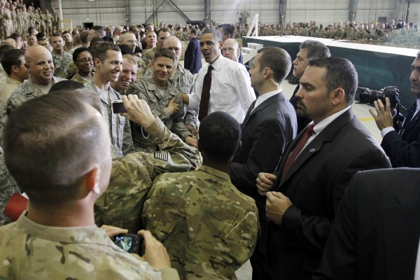 Secret Service agents stand watch as President Barack Obama greets troops at Bagram Air Field, Afghanistan, Wednesday, May 2, 2012.