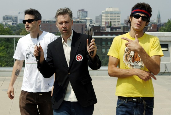 Beastie Boys members Adam Yauch (center), &quotMCA,&quot Adam Horovitz (left), &quotAdrock,&quot and Mike Diamond, &quotMike D,&quot reflected in a mirror, pose for a photograph during an interview in Toronto, Wednesday, July 26, 2006.