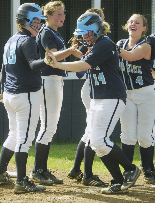 Ocean Side's Kennadi Grover (14) is greeted by teammates at home plate after hitting a solo home run in the third inning aganist Medomak Valley at Thomaston Wednesday afternoon.