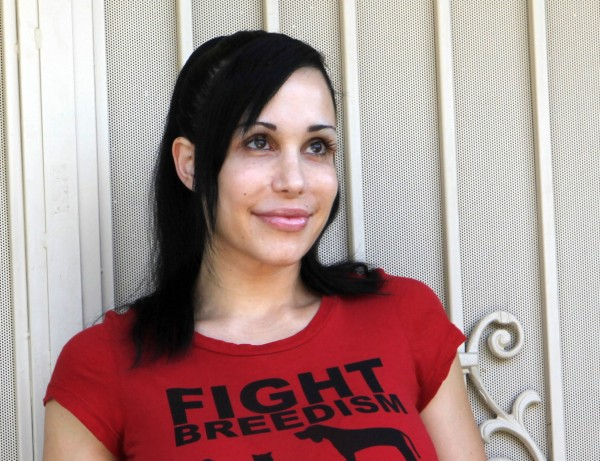 In this May 19, 2010 file photo, mother of octuplets Nadya Suleman wears a T-shirt promoting pet birth control outside her home in La Habra, Calif. Suleman has filed for bankruptcy, saying in a court filing that she has as much as $1 million in debt.