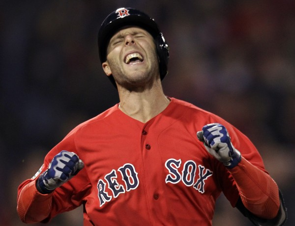 Boston Red Sox's Dustin Pedroia reacts as he flies out to right field, leaving a man on, to end the seventh inning against the Baltimore Orioles in a baseball game at Fenway Park in Boston, Friday, May 4, 2012.