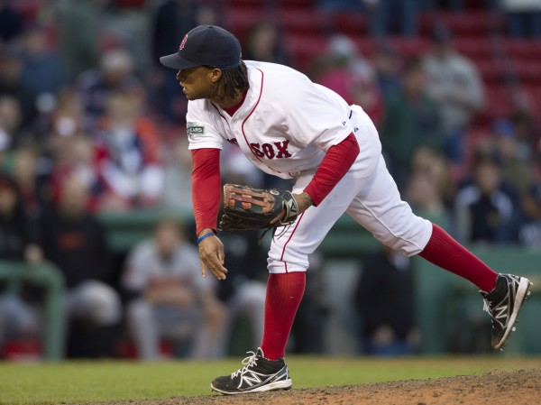 Boston Red Sox's Darnell McDonald pitches to a Baltimore Orioles batter in the 17th inning of a baseball game at Fenway Park, in Boston, Sunday, May 6, 2012. The Orioles defeated the Red Sox 9-6 in 17 innings.