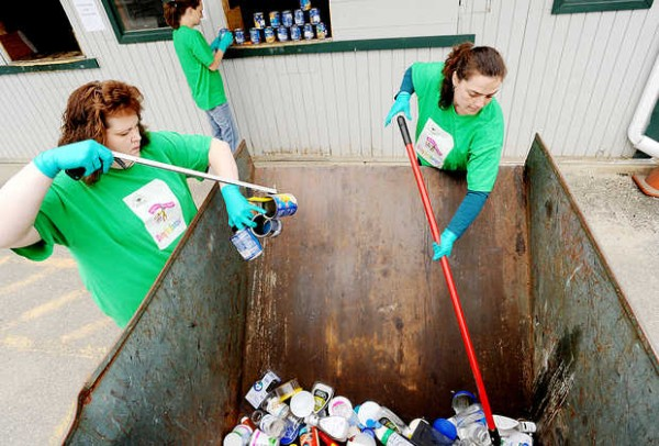 Suzanne Miller, left, Amanda Plourde, back, and Chrissie Maney search for Box Tops at the transfer and recycling center in Lisbon Falls. Members of the Lisbon Community School PTO dig for Box Tops once each month to raise money for the school.