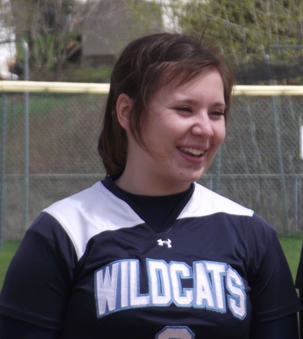 Kailey Shaw, a 17-year-old junior at Presque Isle High School, waits on Saturday, May 12, 2012, for the start of her final varsity girls softball doubleheader. Shaw has moderate ulcerative colitis and autoimmune hepatitis in the liver and had her colon removed in February.