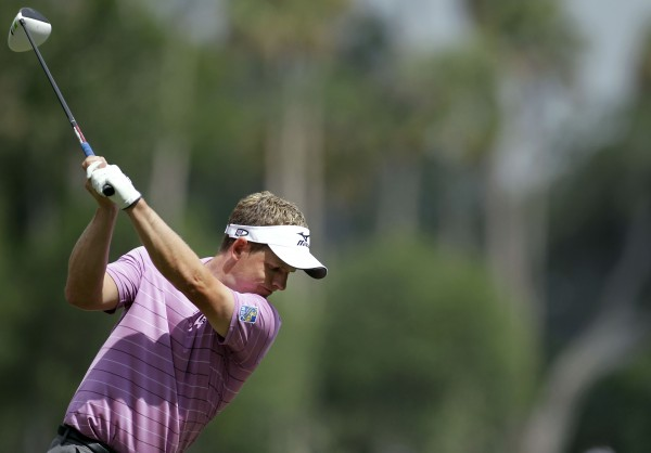 Luke Donald of England tees off on the ninth hole during a practice round for The Players Championship golf tournament Tuesday, May 8, 2012, at Sawgrass in Ponte Vedra Beach, Fla.