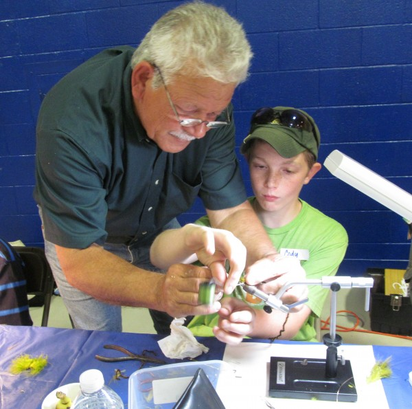 Lane Soltesz of Bowdoin teaches Cody Phillips of Waterford how to tie a fly at the Trout Unlimited fly-fishing table at the Southern Maine Water Festival on Friday, May 18, 2012, at the Portland campus of University of Southern Maine.