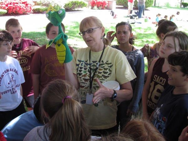 Kathy Murray of the Maine Department of Agriculture introduces students to Izzy the praying mantis on Friday, May 18, 2012, during an activity at the Southern Maine Children's Water Festival in Portland.