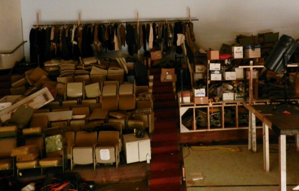 Rather than patrons, the Penobscot Theatre Company's balcony is filled with costumes and stacks of seats, piled up to make room for other items.