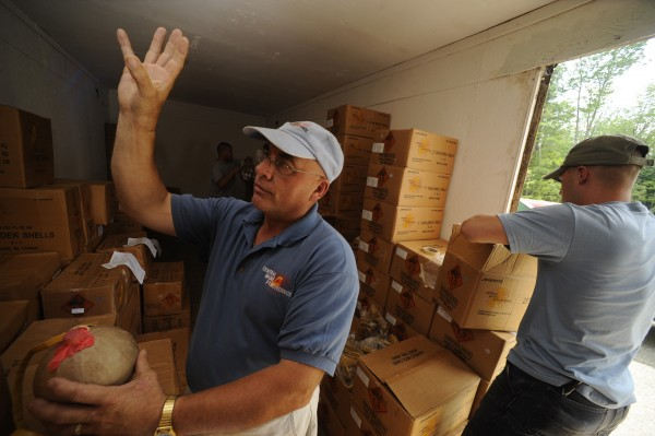 In one of the magazines at the Central Maine Pyrotechnics storage and packing facility near its Hallowell office, president Steve Marson (left) helps magazine managers Patrick Fitzmaurice (right) and Marson's son Anthony (background) gather and count shells recently for fireworks displays in 2009.