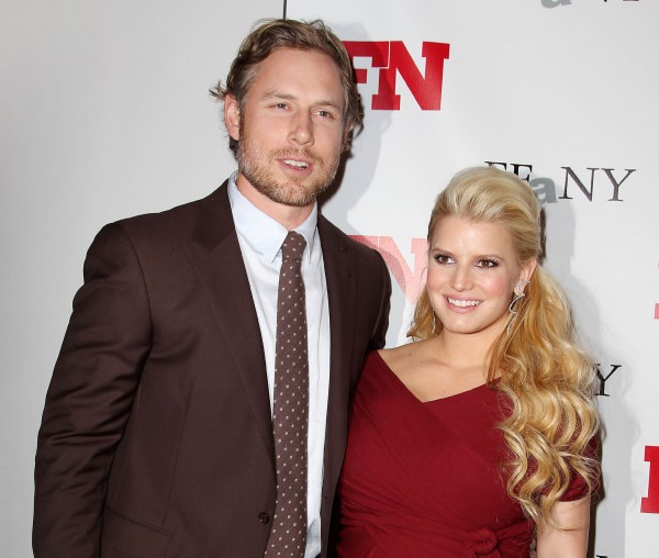 In this Nov. 29, 2011 file photo, singer Jessica Simpson, right, poses with her fiance Eric Johnson at the 25th Annual Footwear News Achievement Awards at The Museum of Modern Art in New York. A publicist for the singer confirmed Simpson gave birth to a daughter named Maxwell Drew Johnson in Los Angeles on Tuesday, May 1.