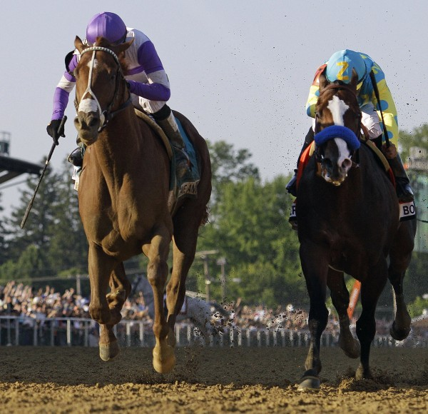 I'll Have Another, left, ridden by Mario Gutierrez, leads Bodemeister, ridden by Mike Smith to win the 137th Preakness Stakes horse race at Pimlico Race Course, Saturday, May 19, 2012, in Baltimore.