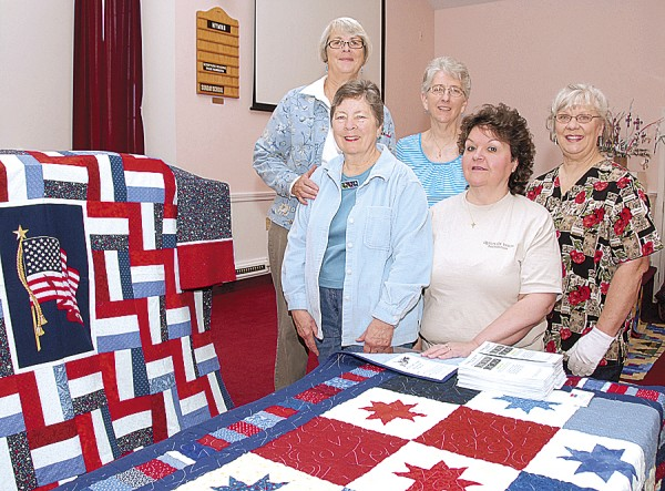 Posing with the Quilts of Valor sewn by members of the Women's Fellowship of East Orrington Congregational Church are (from left) Carol Small of Orrington, Linda Weinmann of Orrington, Beverly Richardson of Orrington, Marie McSwine of Brownville, and Brigitte Schoen of Bucksport. McSwine is the Maine regional coordinator for the Quilts of Valor Foundation. Absent from the photo are quilters Jean Brown of Hermon and Brenda Pelletier of Bucksport.