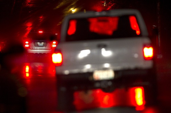 Taillights and a stop light reflect on a rain-soaked Franklin Arterial in Portland on Wednesday evening, May 9, 2012.