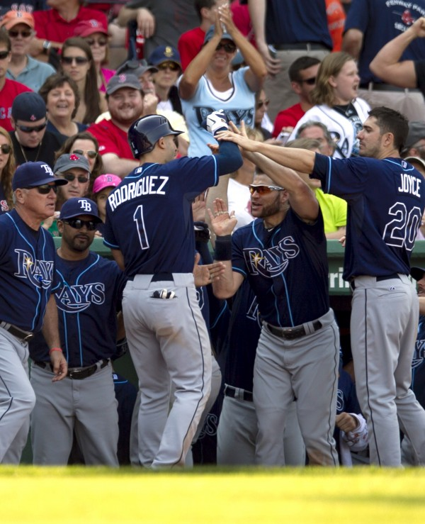 Tampa Bay Rays' Sean Rodriguez (1) celebrates with teammates in the dugout after hitting a two-run home run off a pitch by Boston Red Sox's Alfredo Aceves in the ninth inning of a baseball game at Fenway Park in Boston, Sunday, May 27, 2012. The Rays defeated Boston 4-3.