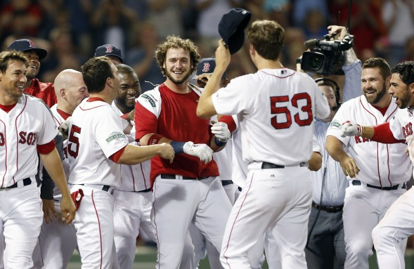 Boston Red Sox's Jarrod Saltalamacchia, center, celebrates with teammates after hitting a two-run home run to defeat the Tampa Bay Rays 3-2 in the ninth inning of a baseball game in Boston, Saturday, May 26, 2012.