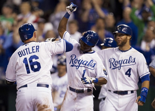 Kansas City Royals' Billy Butler (16) is congratulated by teammates Jarrod Dyson (1) and Alex Gordon (4) after his three-run home run in the eighth inning of a baseball game in Kansas City, Mo., Tuesday, May 8, 2012. The Royals defeated the Boston Red Sox 6-4.